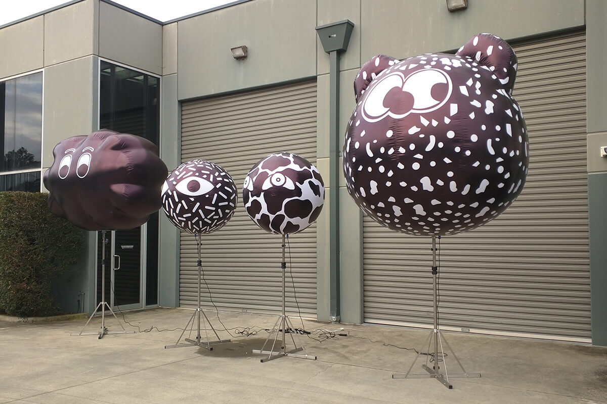 Inflatable Figures On Stands For A Show