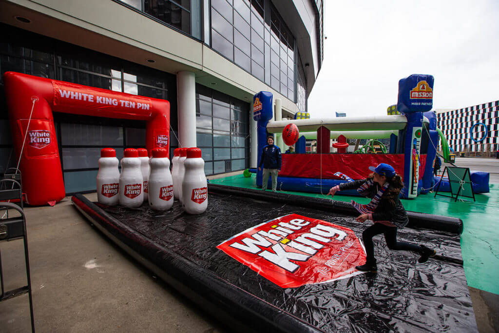 White King Using An Inflatable At An AFL Activation